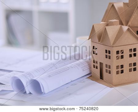 Image of new model house on architecture blueprint plan