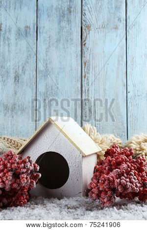 Handmade birdhouse in winter