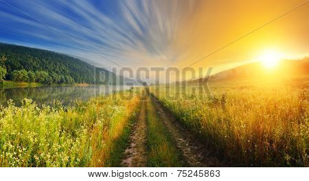 Fantastic foggy river with fresh green grass in the sunlight. Dramatic colorful scenery. Dnister river, Ternopil. Ukraine, Europe. Beauty world.