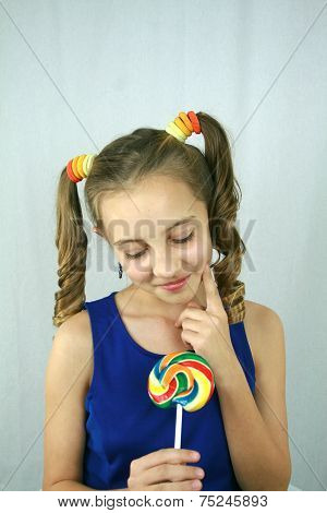Girl Contemplating Lollipop