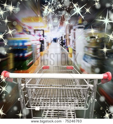 Shopping in supermarket. Shoping cart with christmas lights