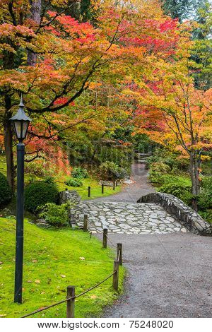 Colorful Fall Foliage and Stone Bridge