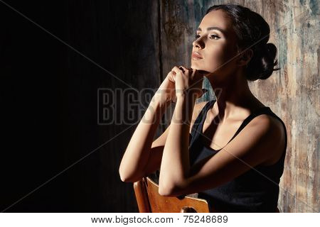 Close-up portrait of a beautiful elegant young woman. Art portrait.