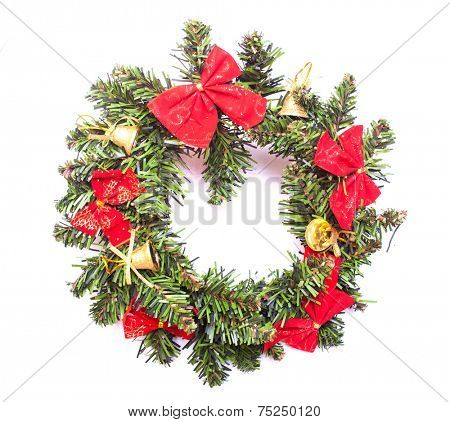 Christmas wreath with red tie and yellow bell isolated on white