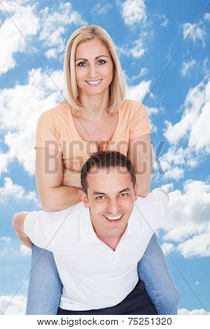 Man Piggybacking His Girlfriend