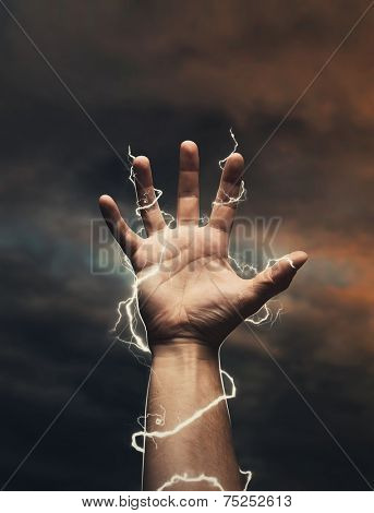 Lightning around men's hand