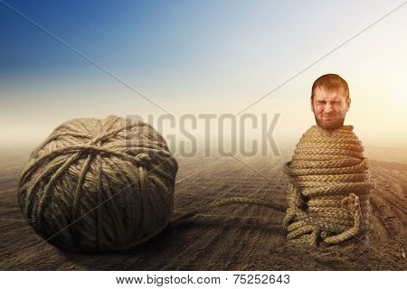 Man in captivity of threads