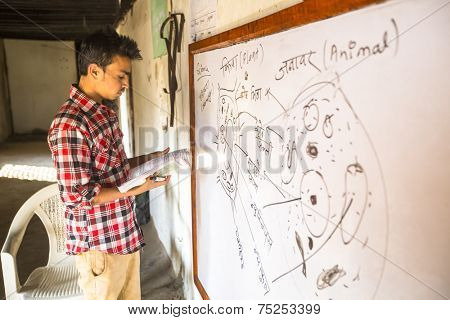 KATHMANDU, NEPAL - DEC 9, 2013: Unknown teacher in lesson at Jagadguru School. School established at 2013, to let new generation learn Sanskrit and preserve Hindu culture.