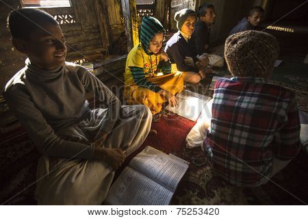 KATHMANDU, NEPAL - DEC 9, 2013: Unknown students in lesson at Jagadguru School. School established at 2013, to let new generation learn Sanskrit and preserve Hindu culture.