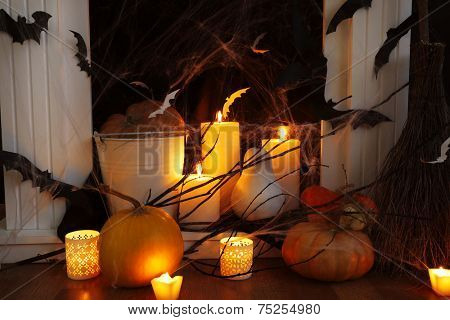 Halloween composition on fireplace closeup