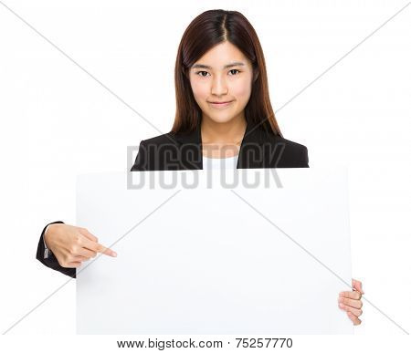 Businesswoman finger point to the white board