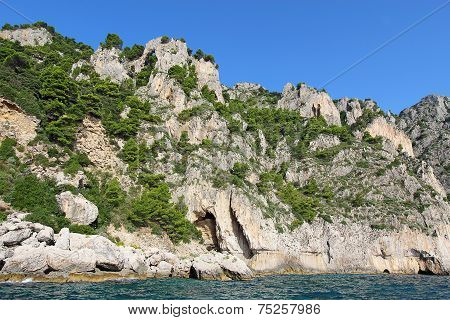 An Arch And Caves On The Coast Of Capri Island, Italy