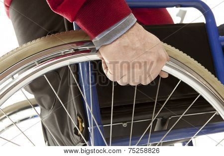 Wheelchair user makes various movements with his wheelchair, exercises for safety handling