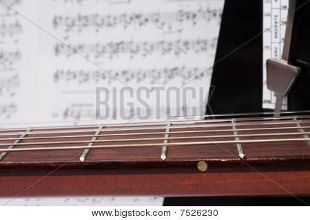 Closeup Guitar Neck, Notes And Metronome