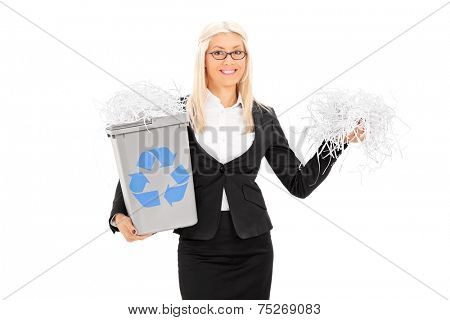 Busineswoman holding a recycle bin and bunch of shredded paper isolated on white background