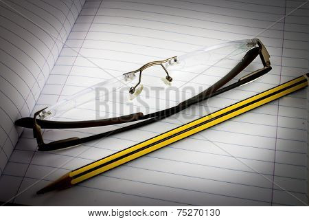 Blank Notebook With Pencil And Glasses