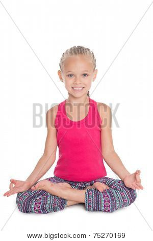 Yoga - little girl in lotus position. Girl is six years old.