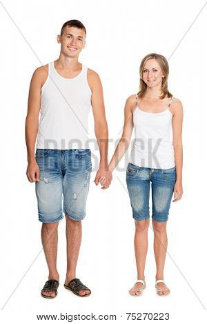 Beautiful smiling young couple in love in breeches and undershirts