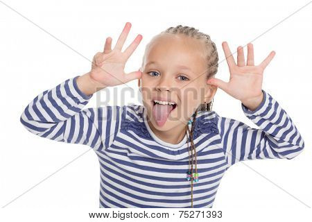 Little girl in the form of a sailor boy jokingly stuck out her tongue. Girl is six years old.