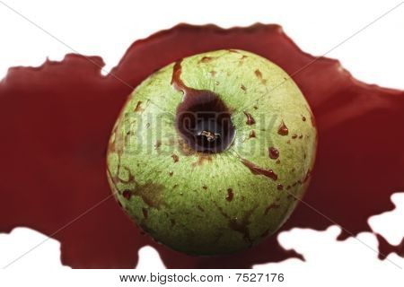 Fresh Green Apple In  Pool Of Blood