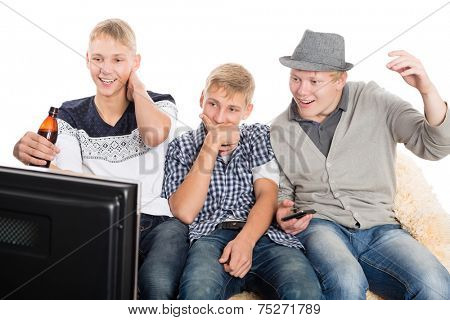 Group of young guys watching your favorite show on TV. Two of the boys twin brothers.