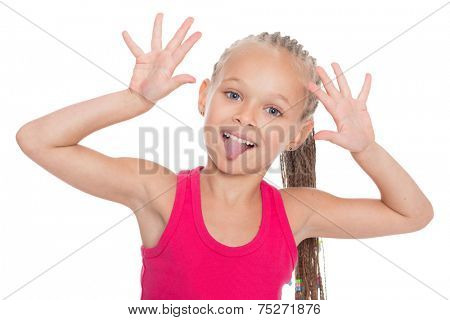 Very playful girl jokingly stuck out her tongue isolated on white. Girl six years.
