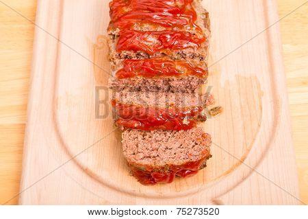 Fresh Baked Meatloaf Sliced On Wood Cutting Board