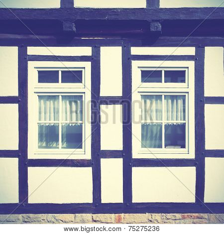 Windows of old timber framing house, Germany. Instagram style filtred image