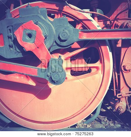 Steam locomotive wheel and rods. Instagram style filtred image