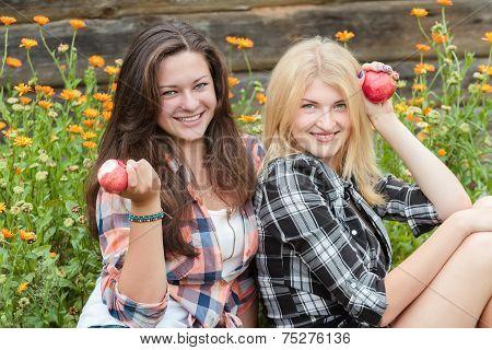 Blonde And Brunette Eating Ripe Apples