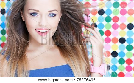 Cheerful attractive young woman on spotted background, beauty and fashion concept