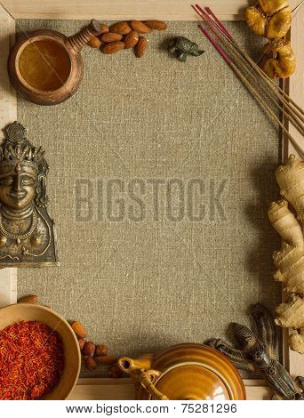 Indian figurines, nuts, saffron and incense with a copy space