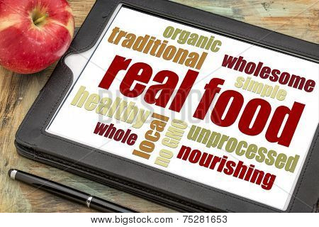 real food word cloud on a digital tablet with an apple - healthy lifestyle concept
