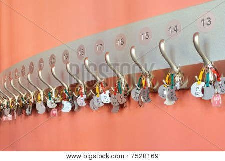 Coat hooks with keychain organized in a row