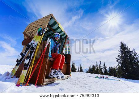 Skiing, winter sport, snow and sun - woman enjoying ski vacation