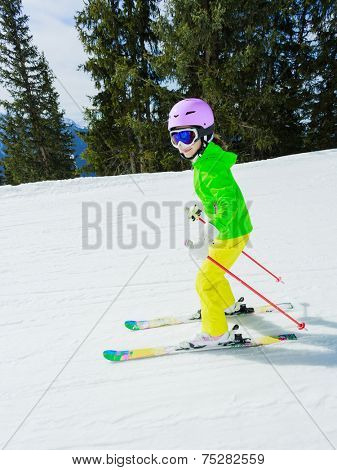 Skiing, winter sport - girl skiing downhill