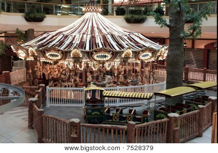circular horse carousel in amusement park setting