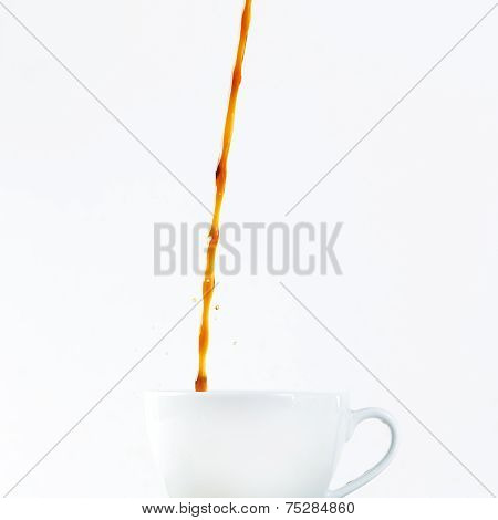 Pouring Coffee In A Cup On White Background. Breakfast.