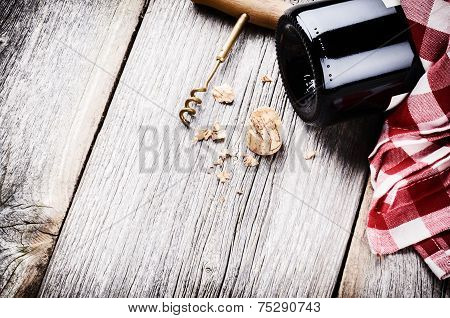 Bottle Of Red Wine In Rustic Setting