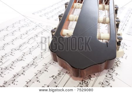 Closeup Guitar Headstock And Notes