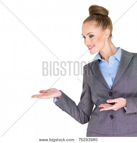 Close up Pretty Smiling Businesswoman in Sky Blue and Gray Business Attire Opening her Hands on the Right Side as if Showing Something. Isolated on White Background.