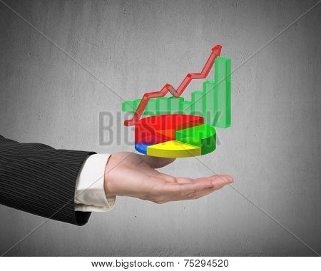 Left Hand Holding 3D Infographics Overlapped On Gray Background
