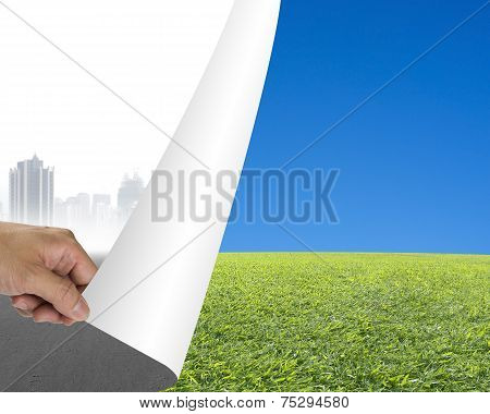 Hand Turning Gray Cityscape Page Revealing Nature Sky Meadow