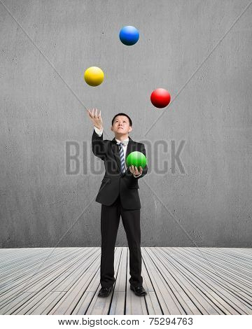 Man Throwing And Catching Colorful Balls