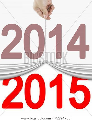 Hand Pulling Up Old 2014 Curtain To Open New 2015
