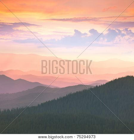 Beautiful Mountains -  sunset time. High peaks, clouds and colorful sunset. Carpathians, Ukraine