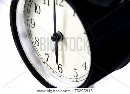 Close-up Of A Vintage Black Clock On White Background