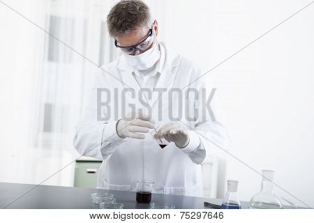 Doctor Working With Microscope And Blood
