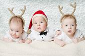 image of christmas baby  - cute babies with deer horns on bright background - JPG