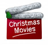 picture of christmas claus  - Christmas movies and holiday classic cinema and TV flicks with a red clapperboard and a Santa Clause hat white fur trim as an entertainment symbol of the winter film industry cinematic releases on a white background - JPG
